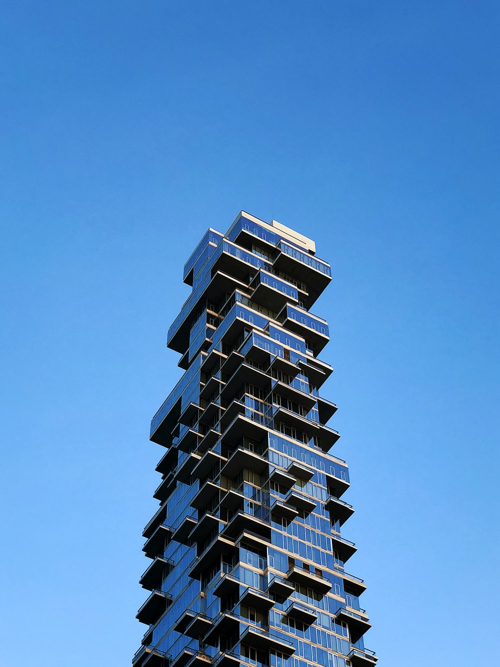 clear glass building under blue sky