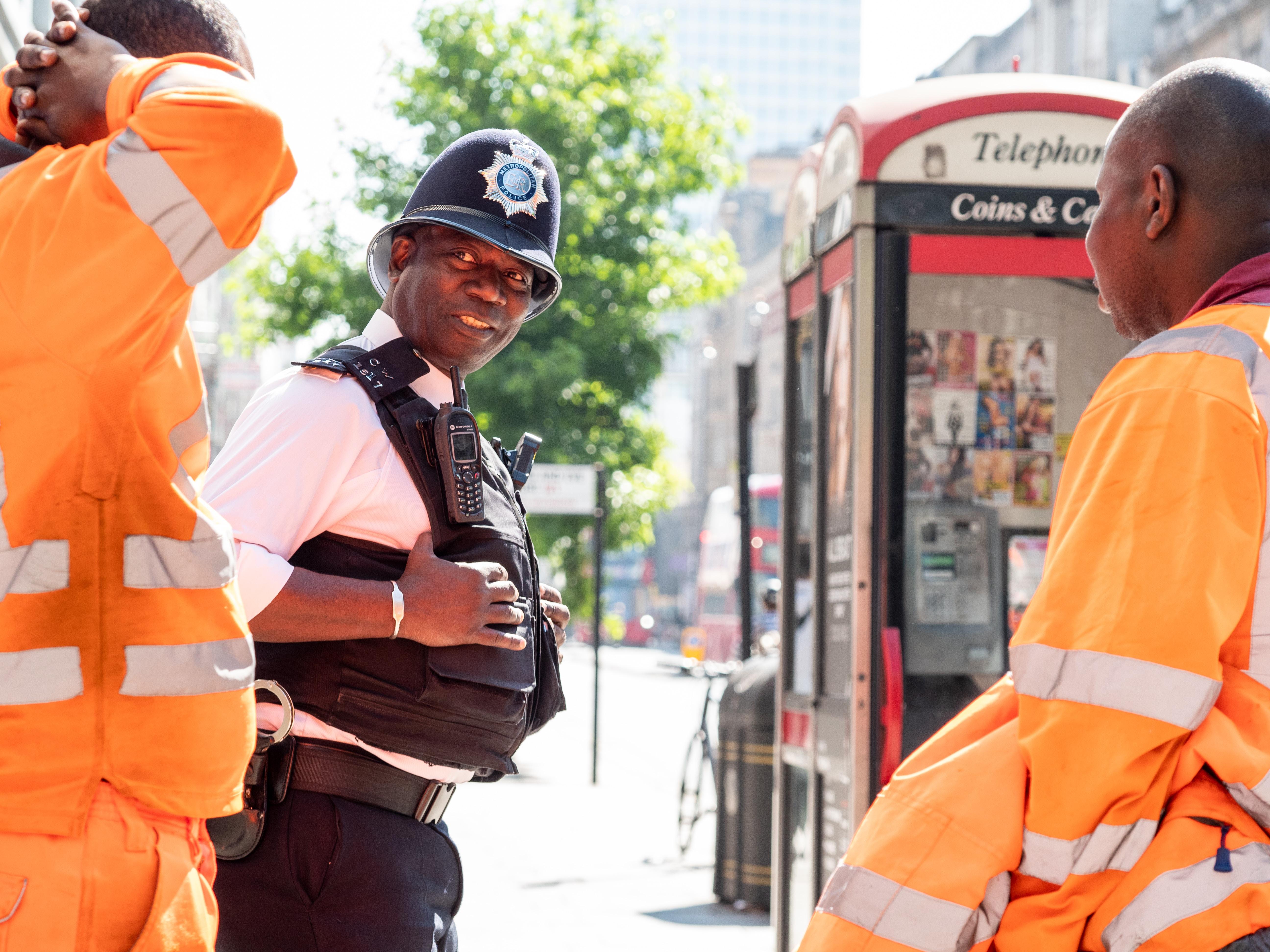 policeman between two firemen