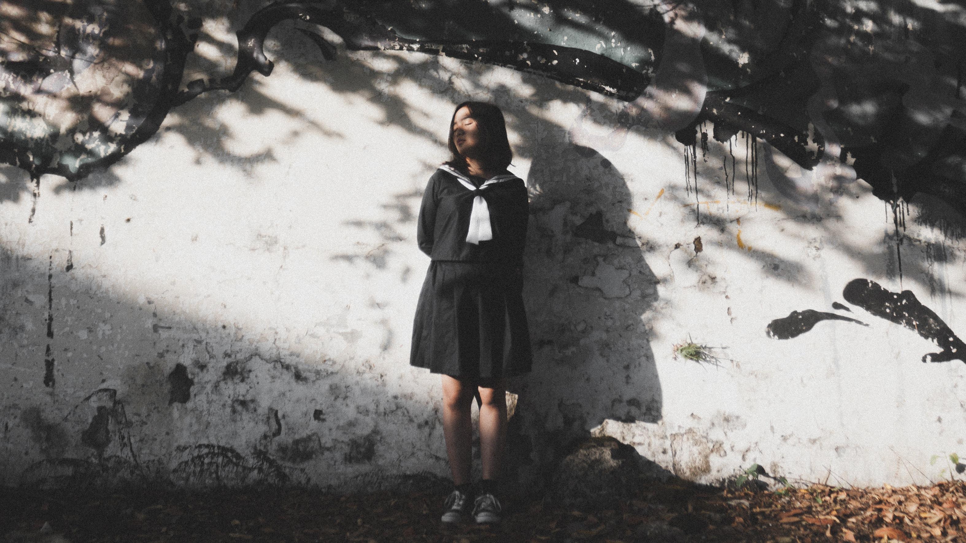 woman standing near wall
