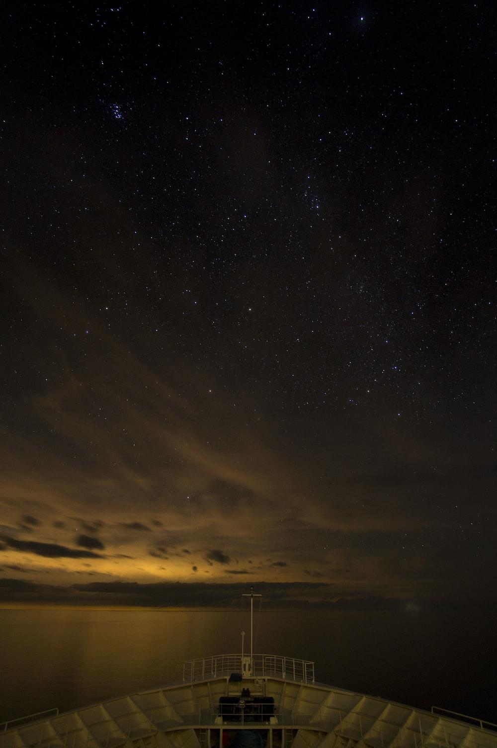 body of water under starry sky