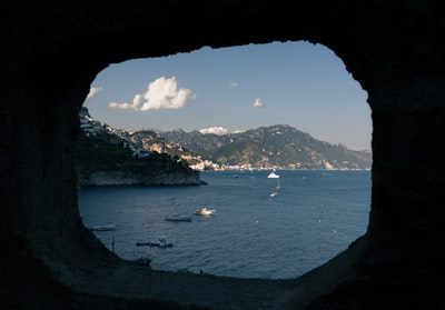 view of body of water with boats amalfi coast teams background