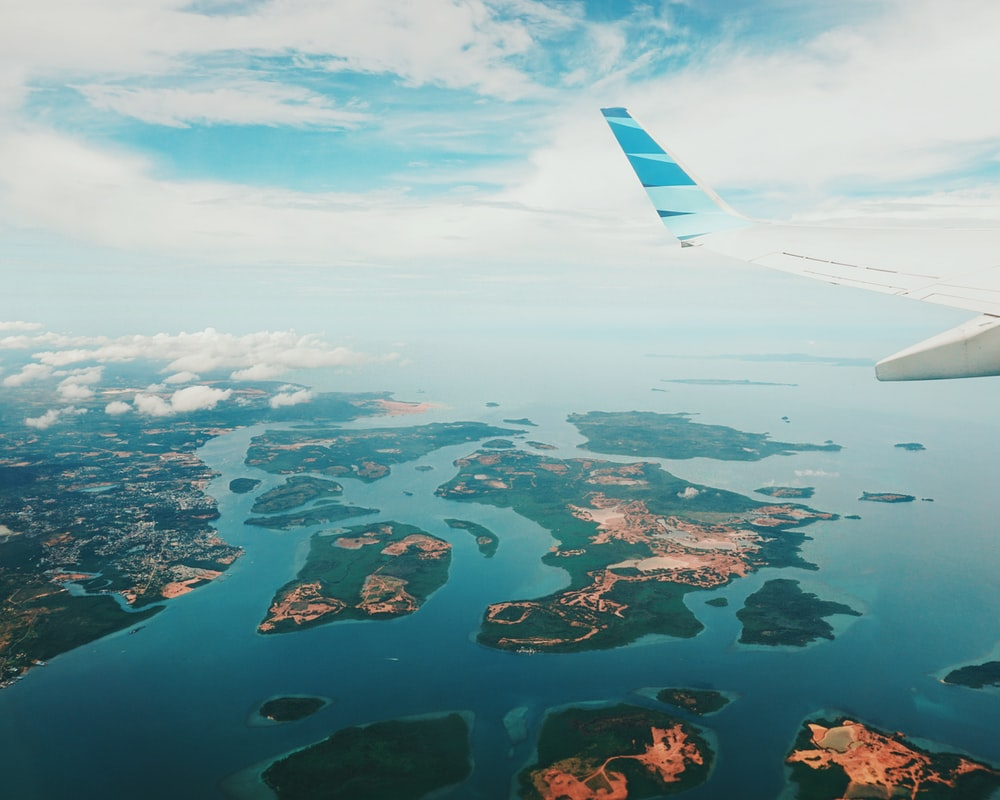 aerial photography of islands from airplane