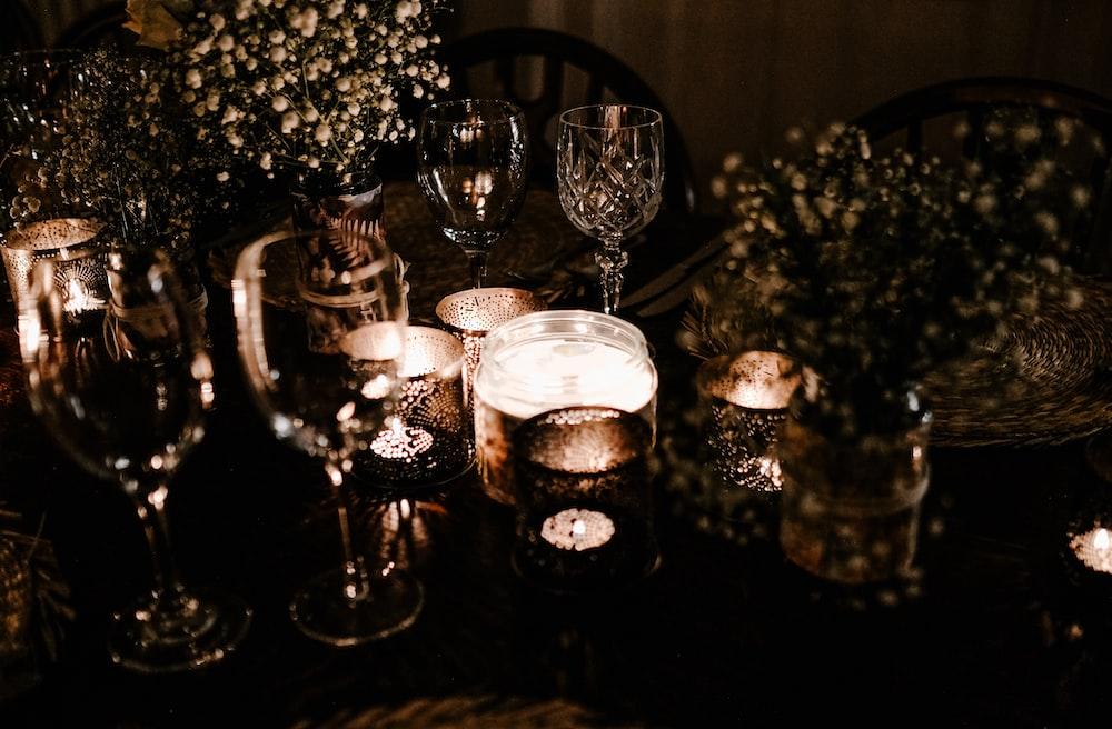 wine glasses beside flower vase
