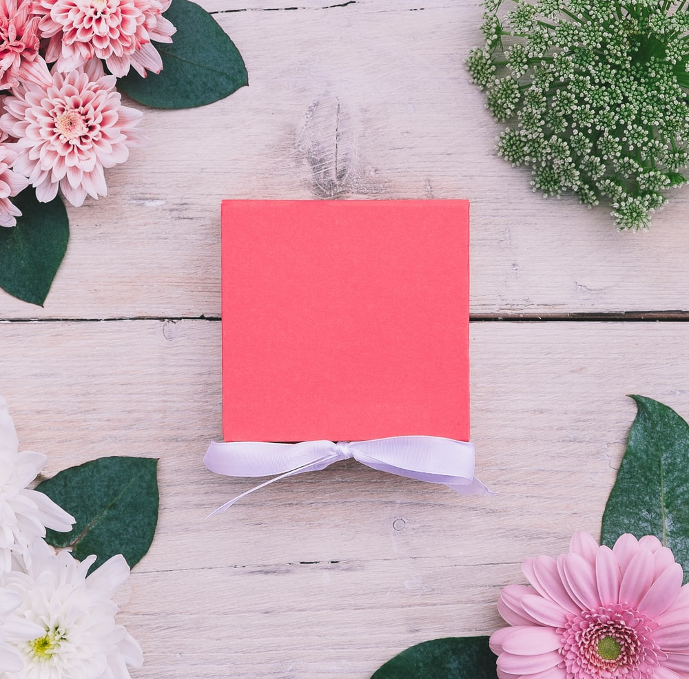pink card on beige wooden surface
