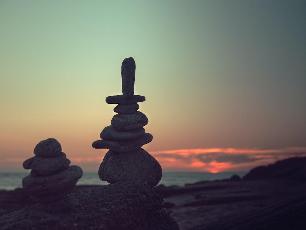 two zen stones on rock