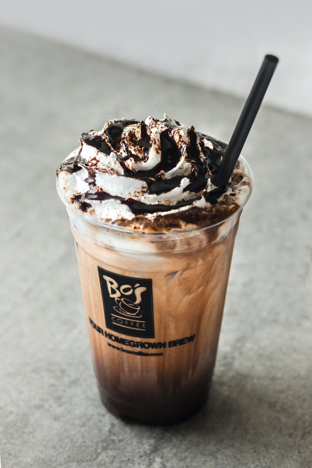 ice coffee cup on gray surface