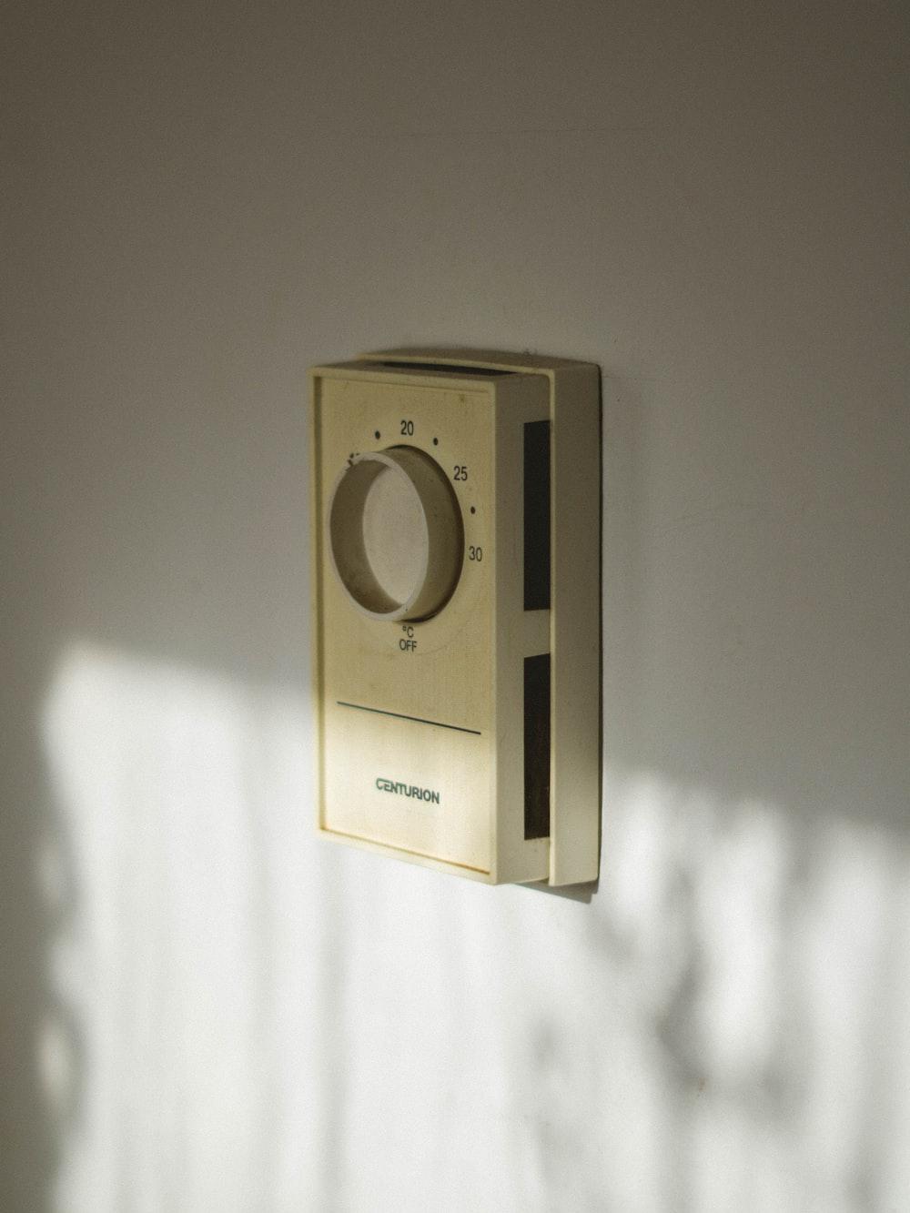 beige Centurion home appliance controller on wall