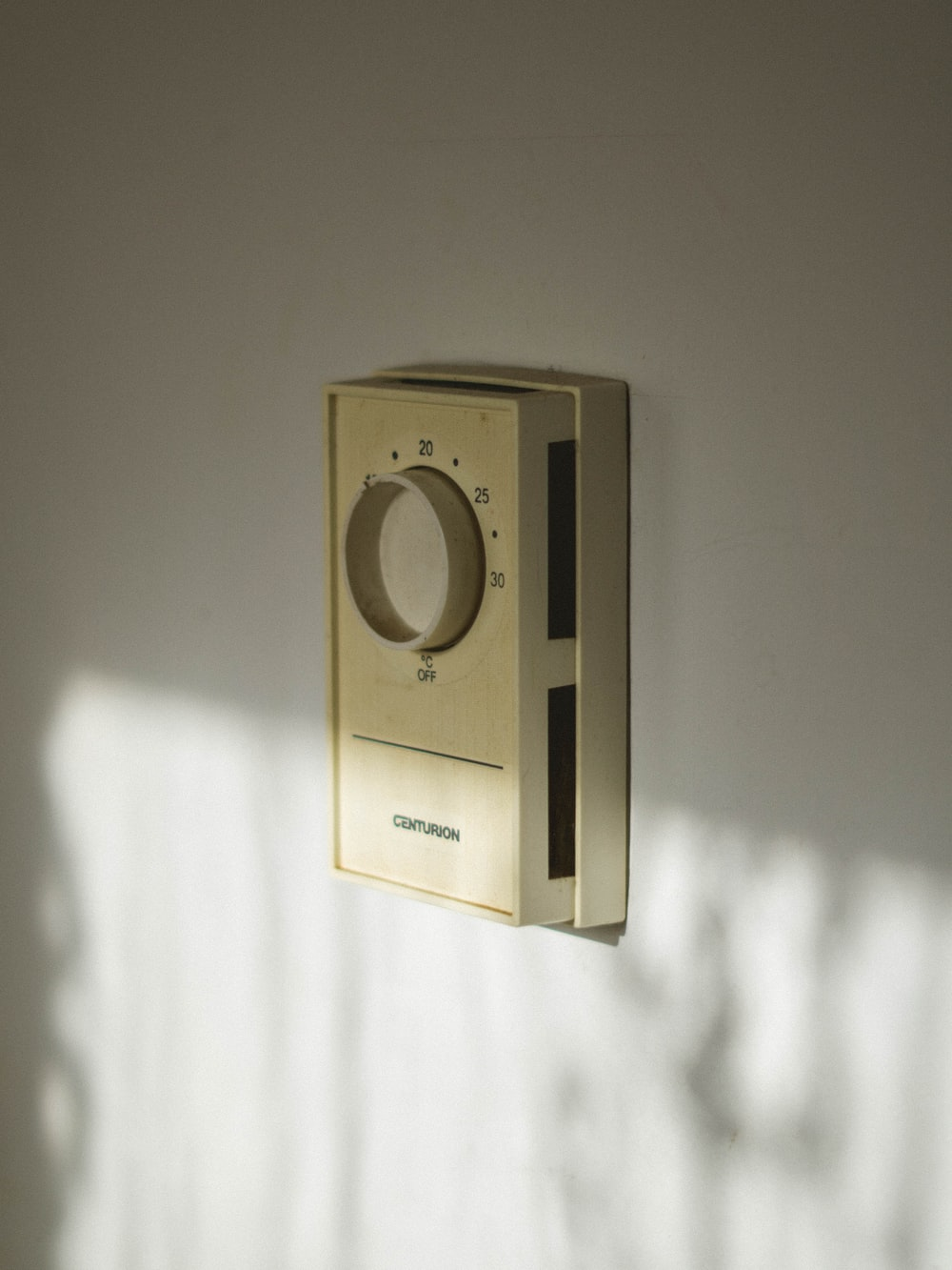 beige Centurion home appliance controller on wall