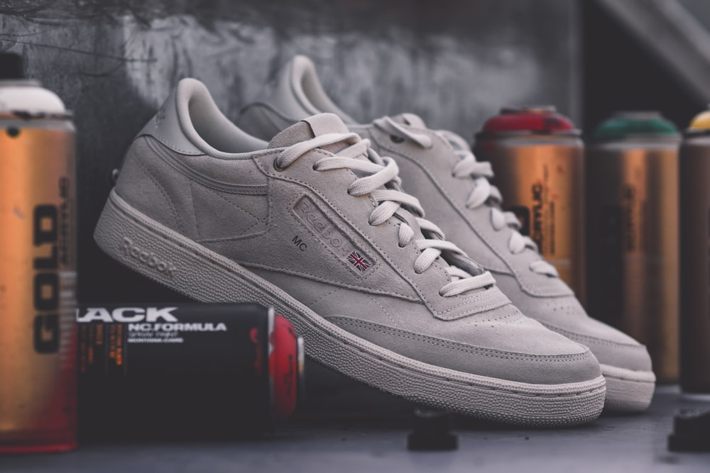 pair of gray Reebok mid-top sneakers