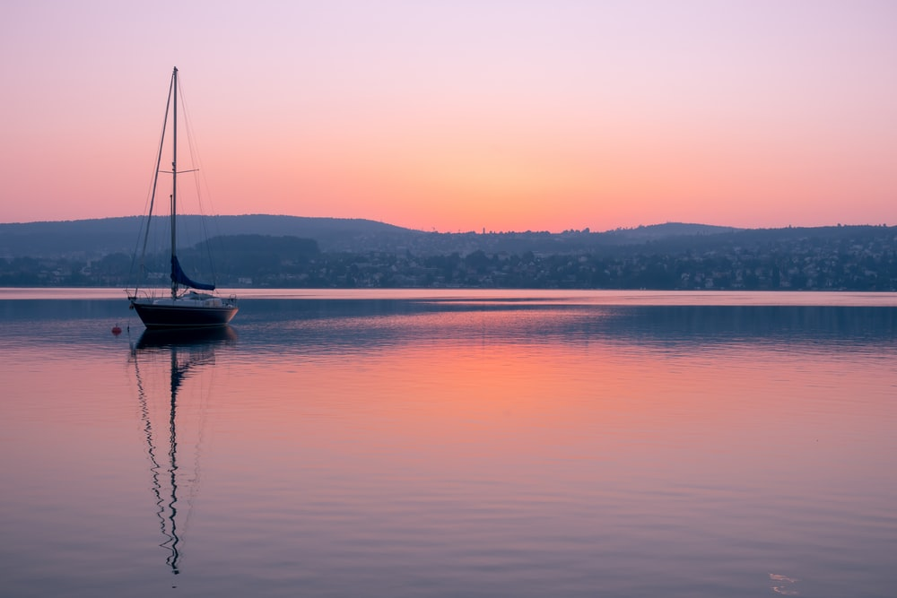 sailboat on water at golden hour
