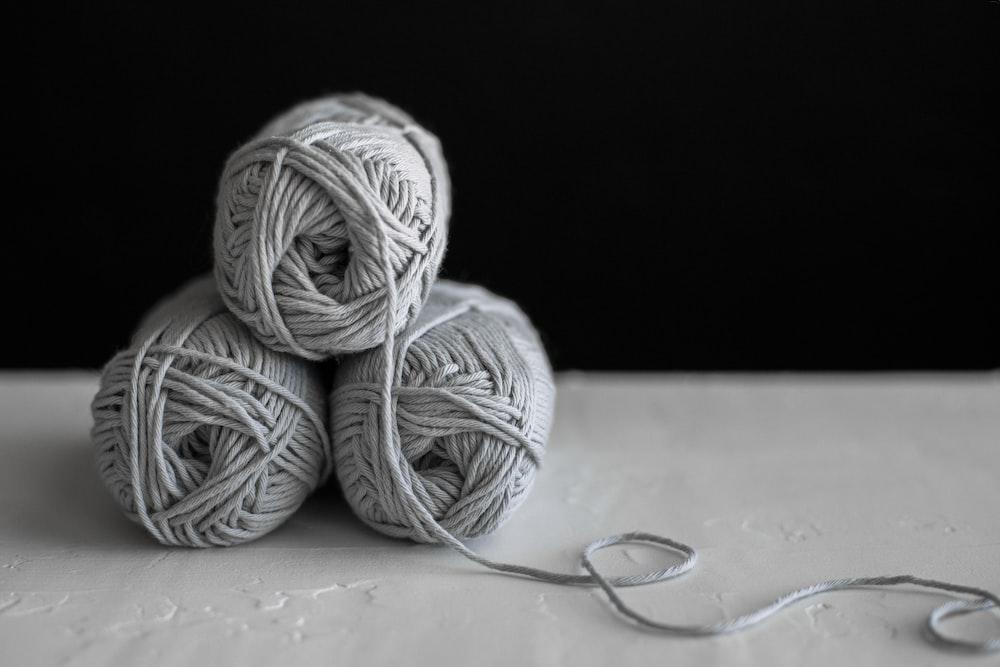 three yarns on table