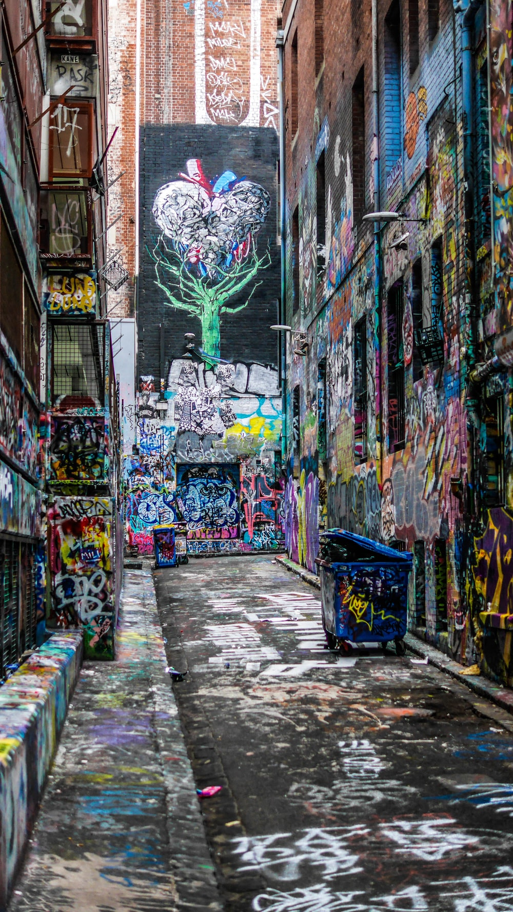 graffiti wall alley during daytime