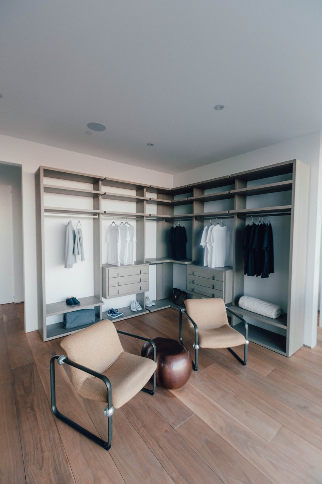 A fashionable, spacious mens closet in this Beverly Hills Home