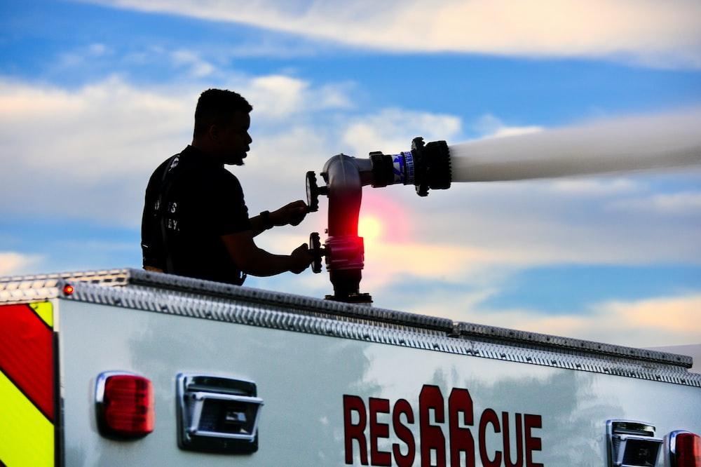 man operating water hose