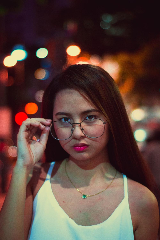 woman holding eyeglasses