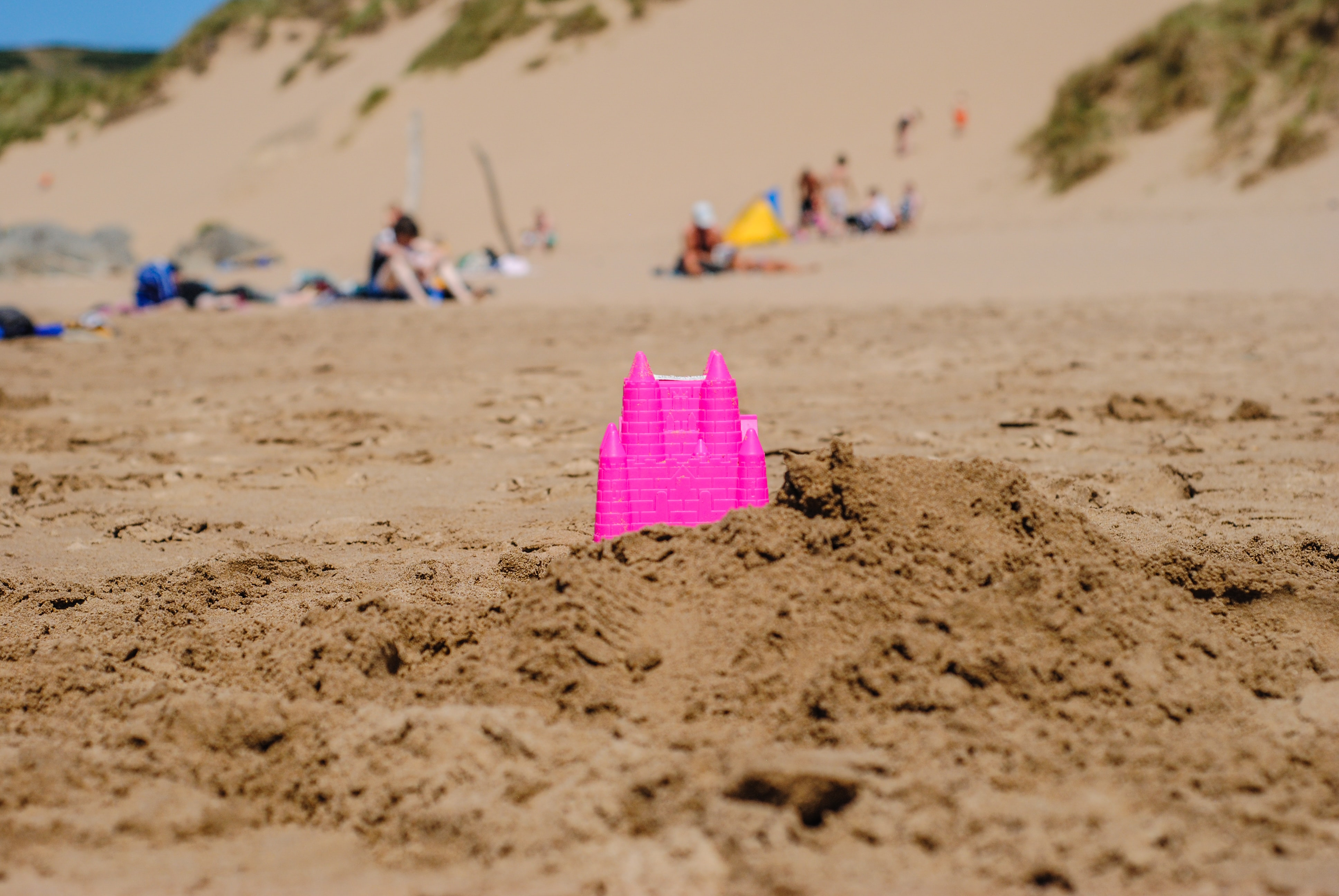 pink castle toy in shore at daytime