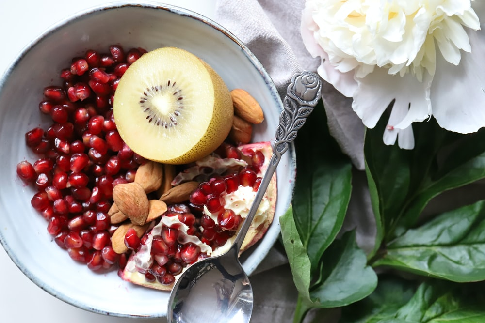 kiwi and peanuts on bowl