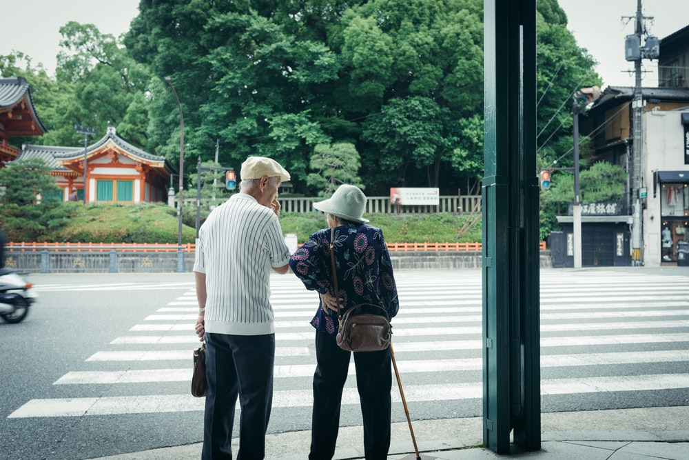 man and woman standing in front of pedestrian line