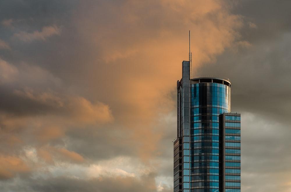 blue concrete building during cloudy sky