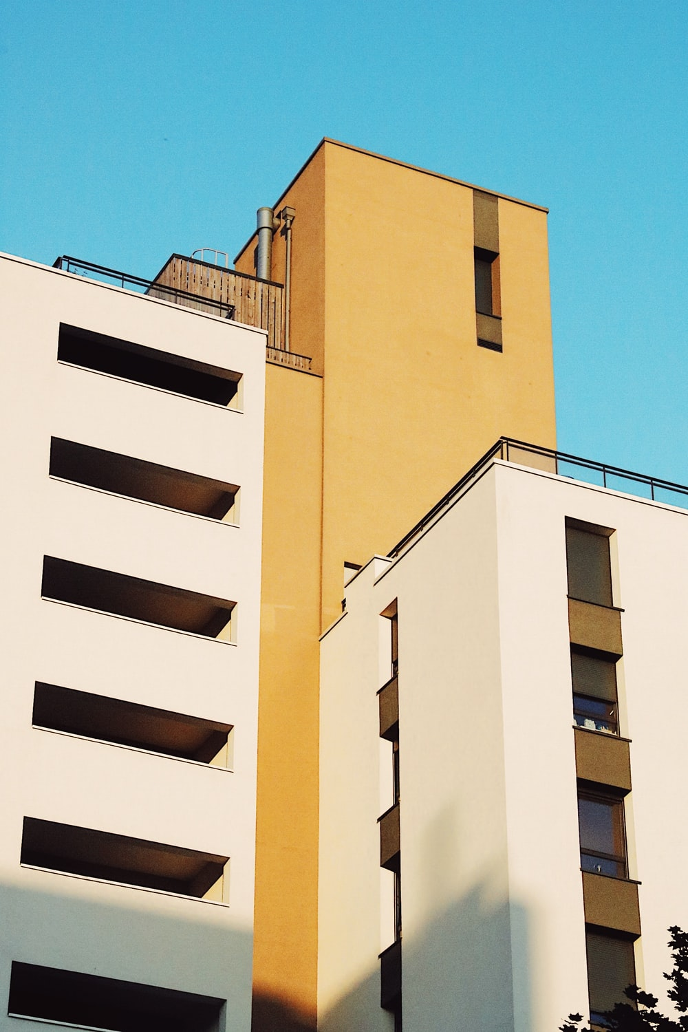 low angle photography of white and orange concrete building