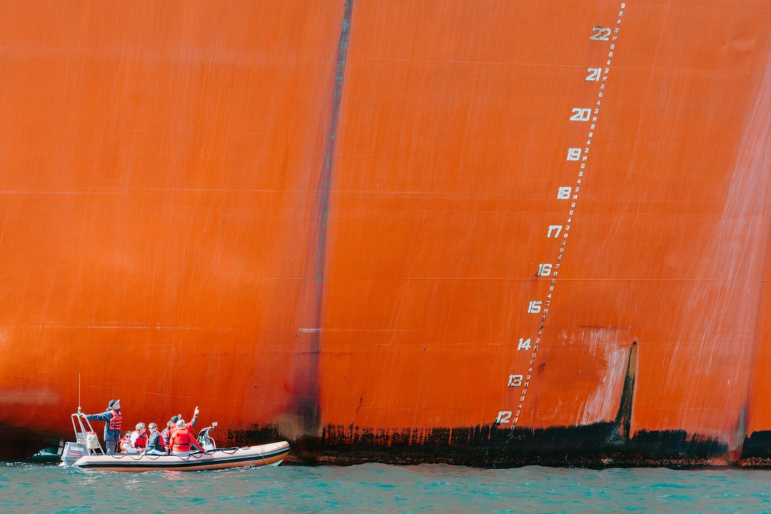 We were on a small boat leaving Falmouth harbour to watch the annual Tall Ships race.  Looking back, I saw this inflatable very close to a moored tanker, it's passengers clearly fascinated by the sheer scale of the larger ship.