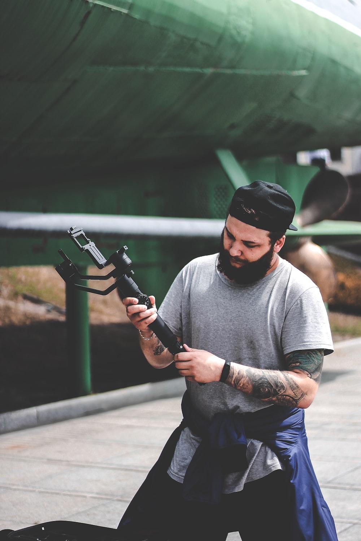 man holding gimbal