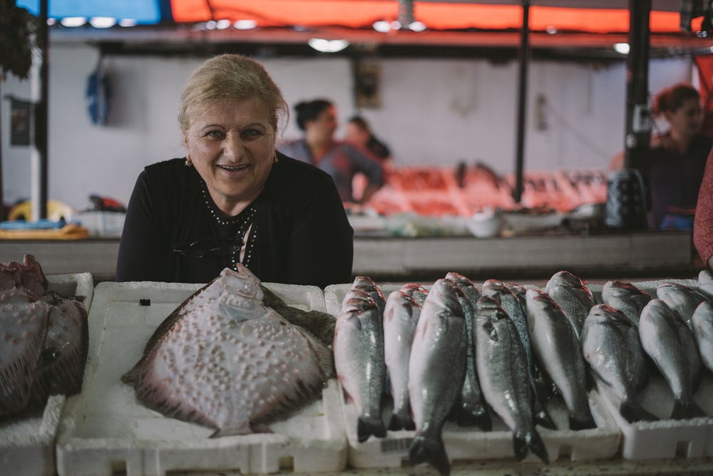 woman standing in front of fish display