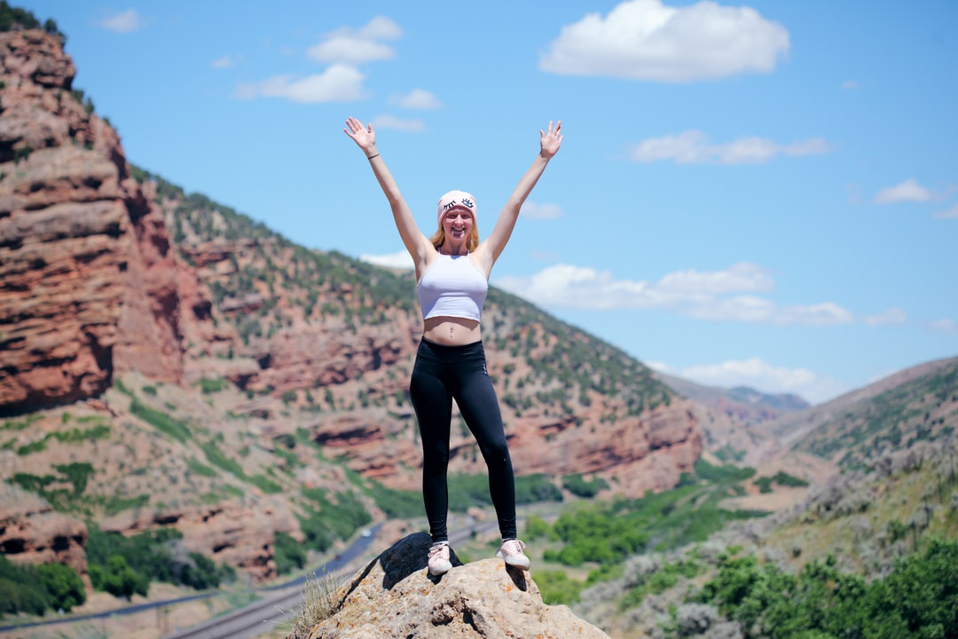 An 18 year old young person proud of making it to the top of the rock. We made a stop at the rest area in Echo, Utah to get some photos.