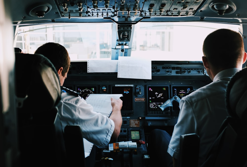 two men inside the plane