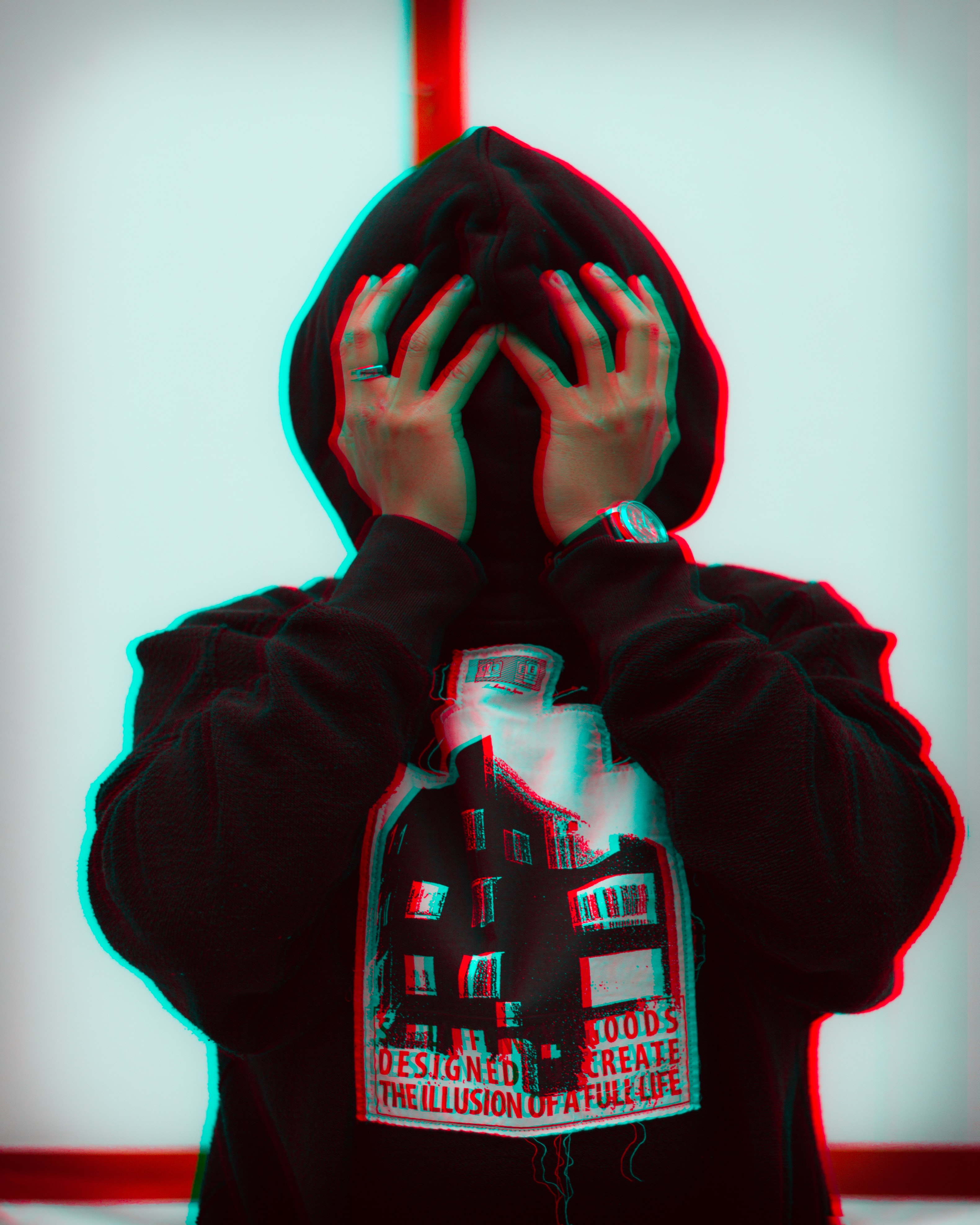 person wearing black pullover hoodie