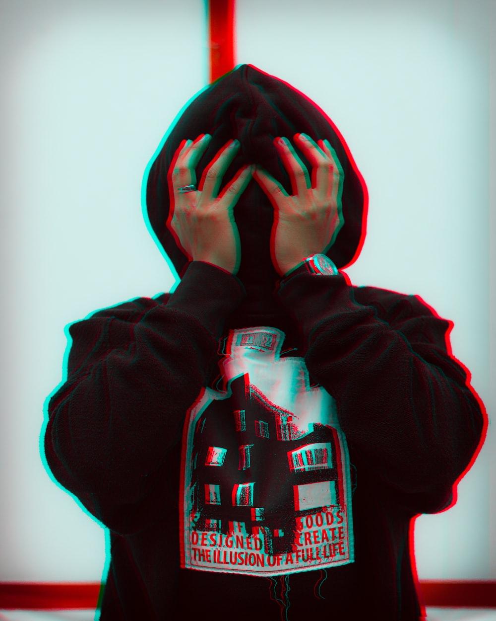 person wearing black pullover hoodie