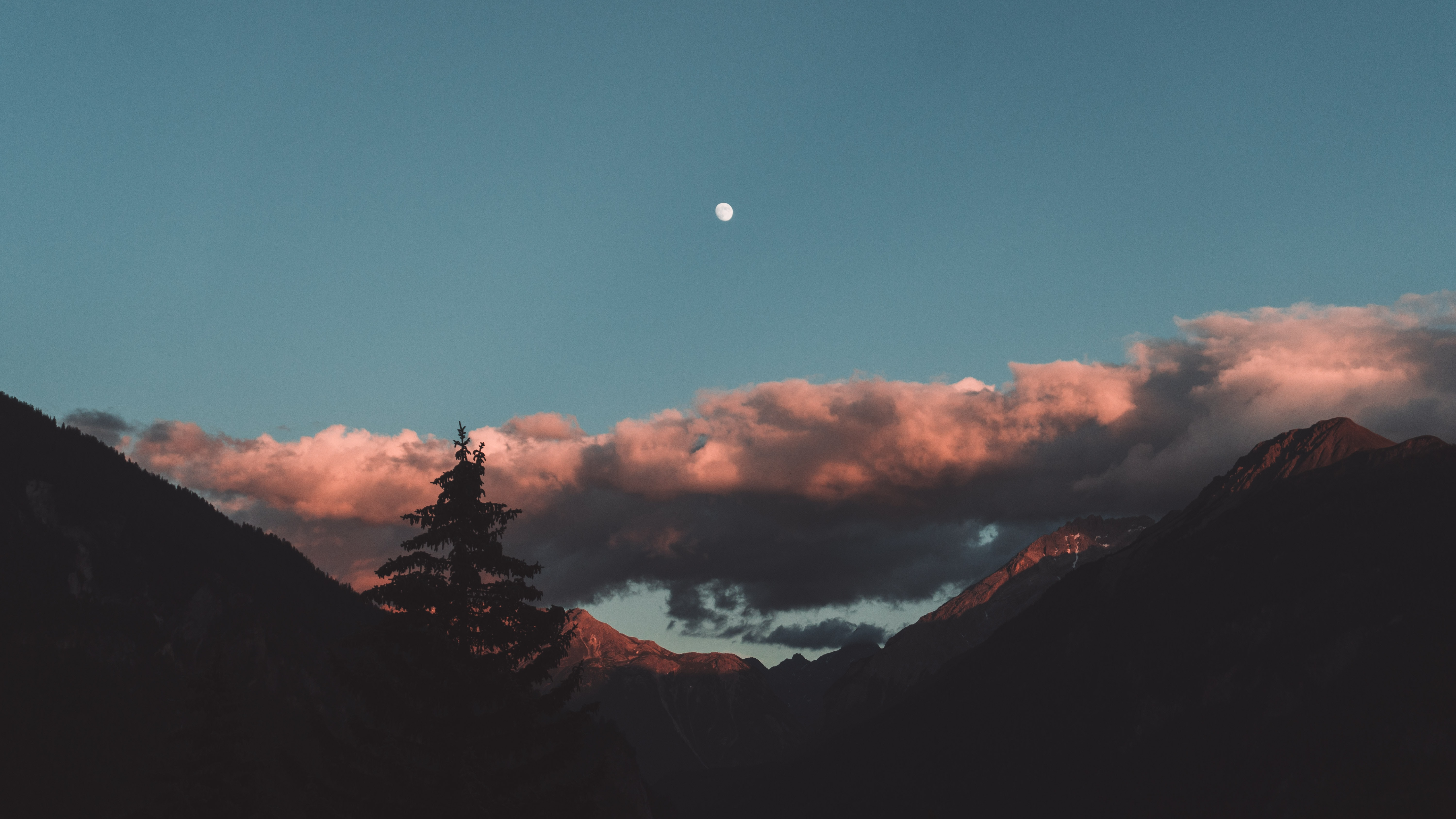 silhouette photo of mountain with clouds