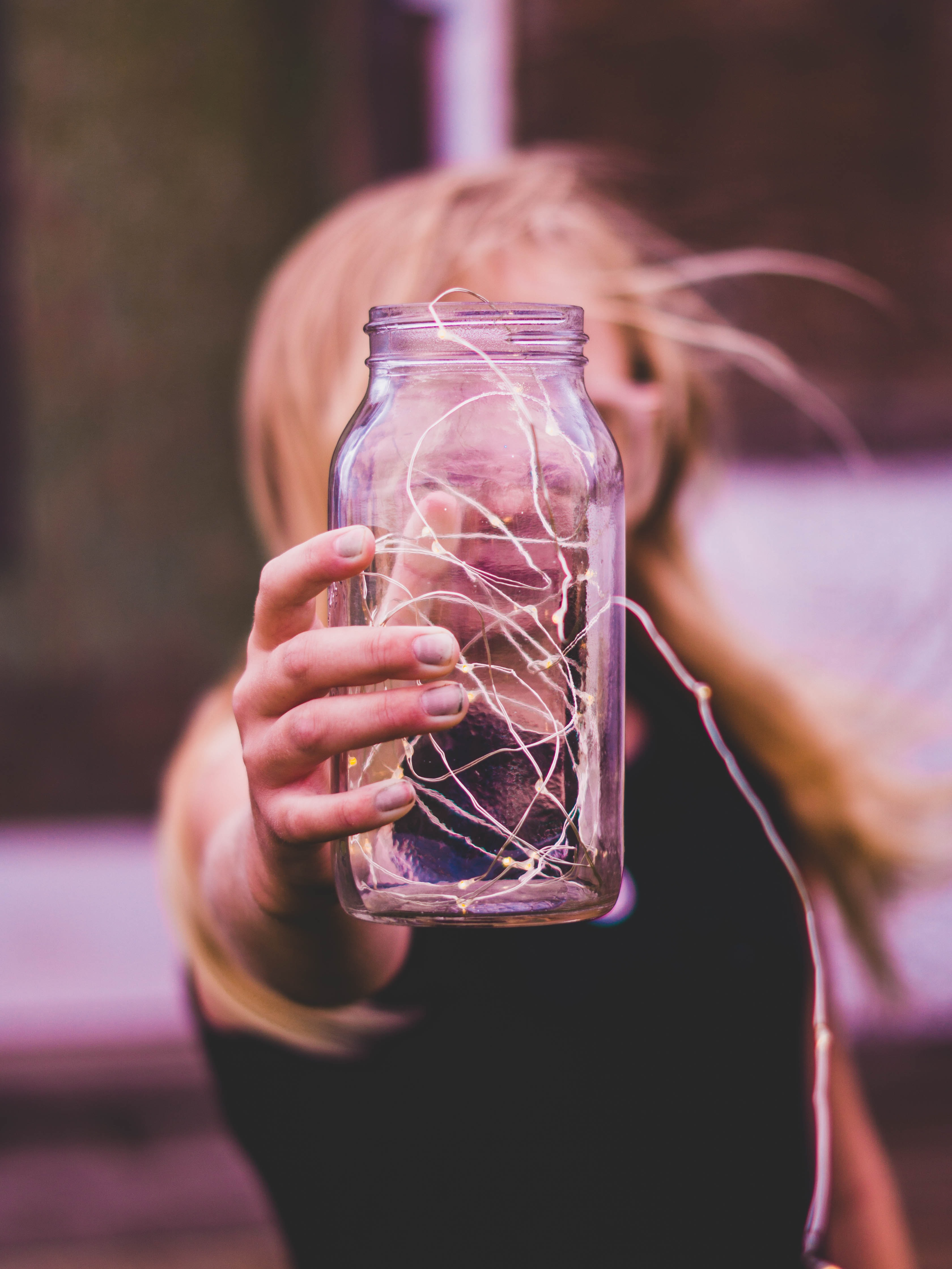 selective focus photography of glass jar