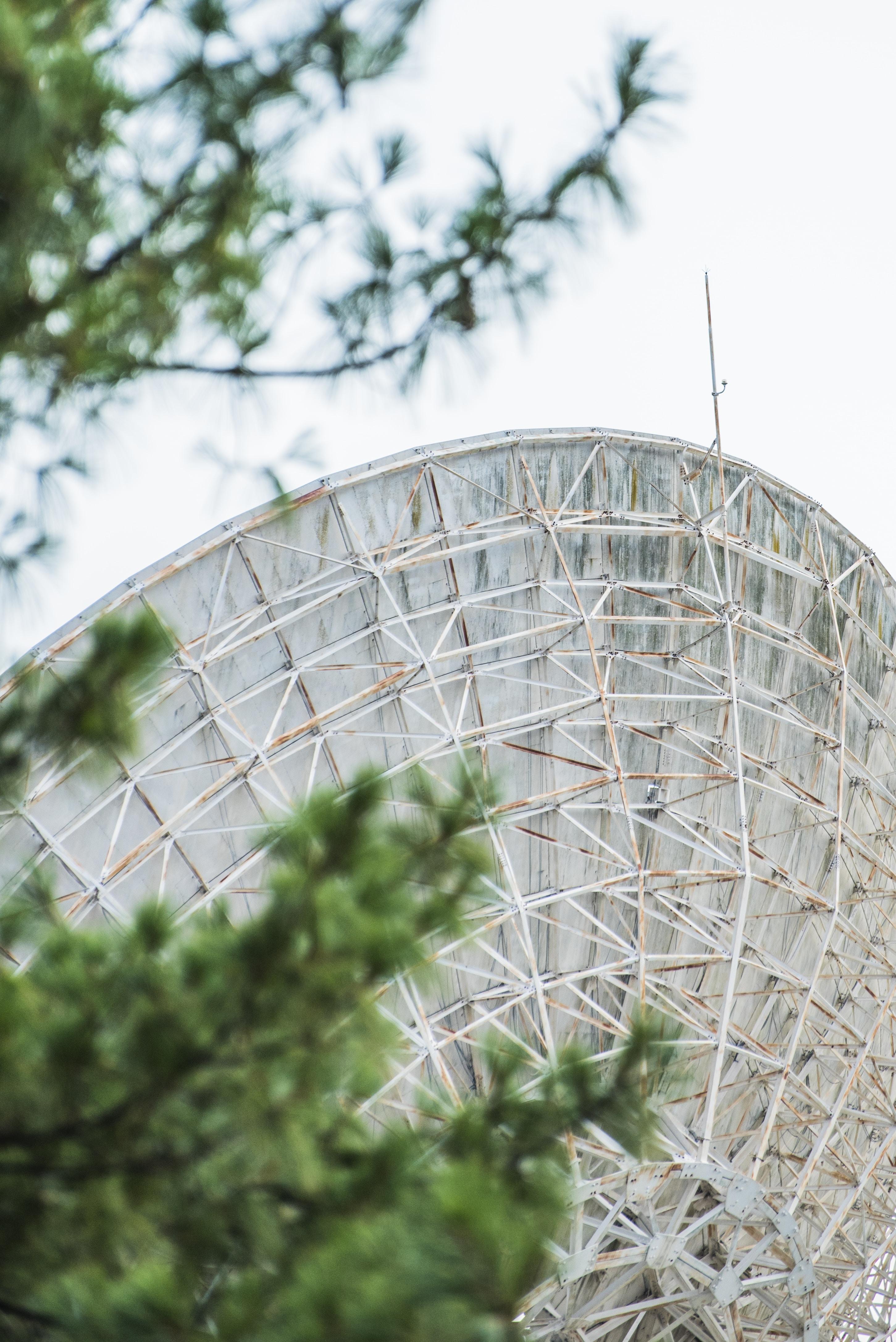 round gray metal industrial machine near trees