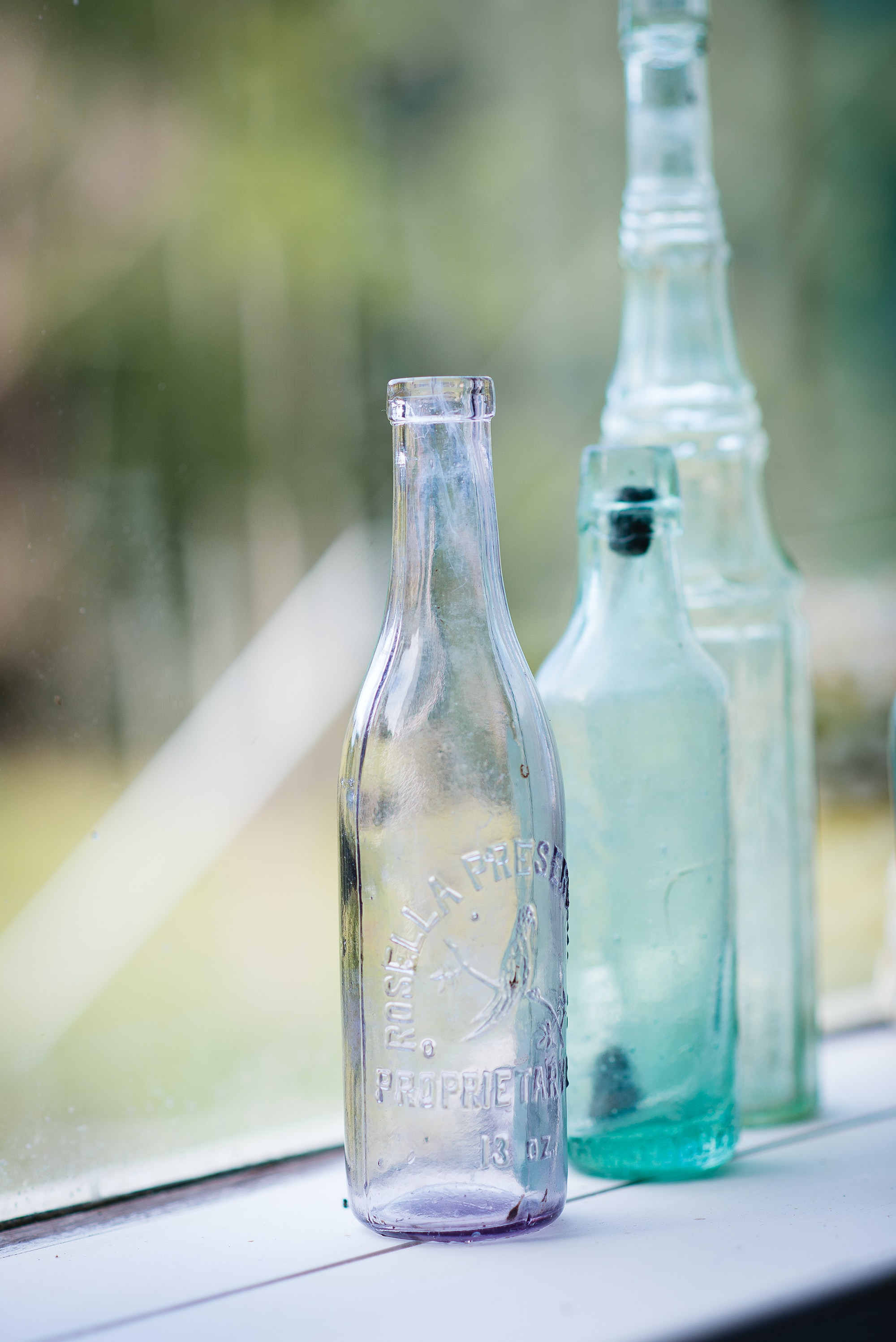 selective photo of three clear glass bottles