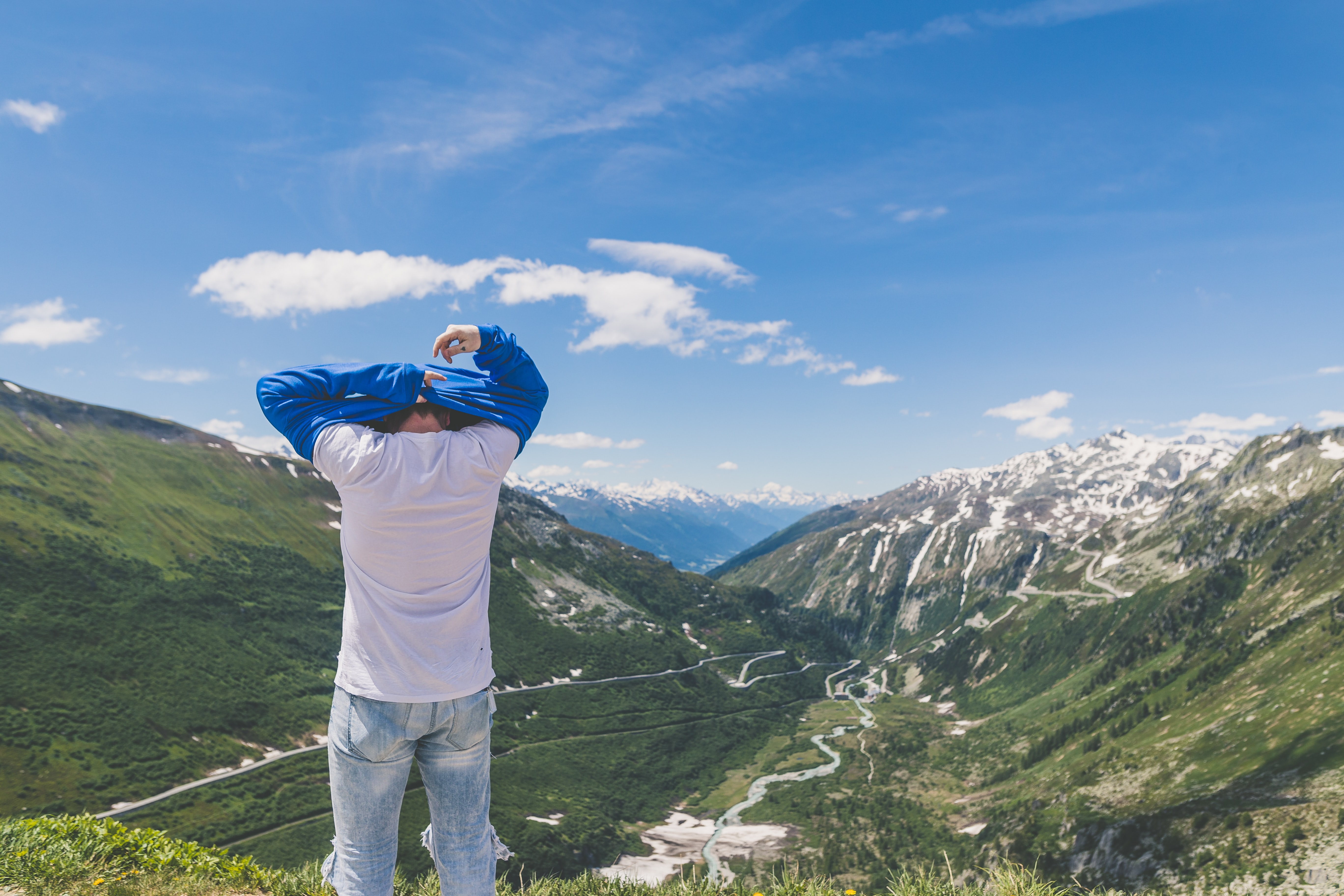 man standing in front of the mountain