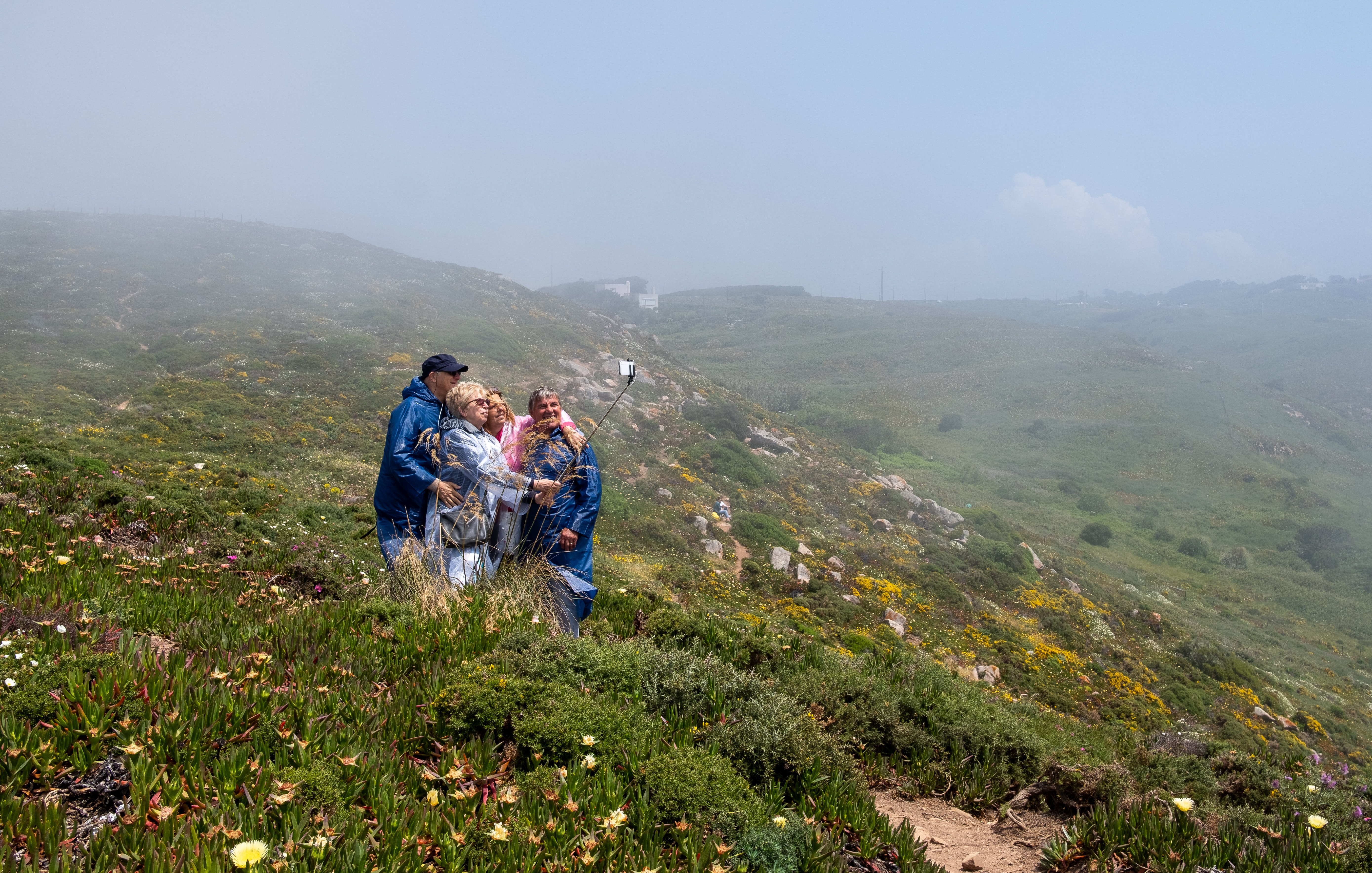 group of people standing on mountain