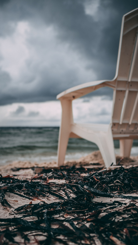 Adirondack chair on seashore