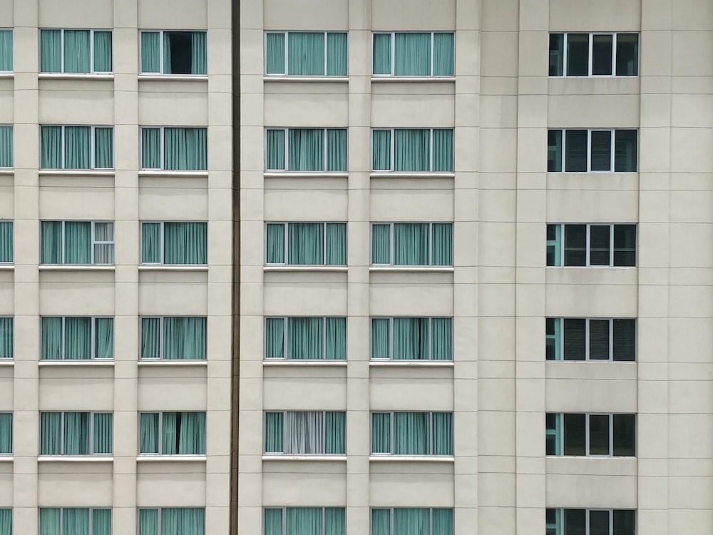 white concrete high rise building