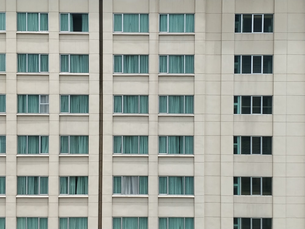 white concrete high rise building