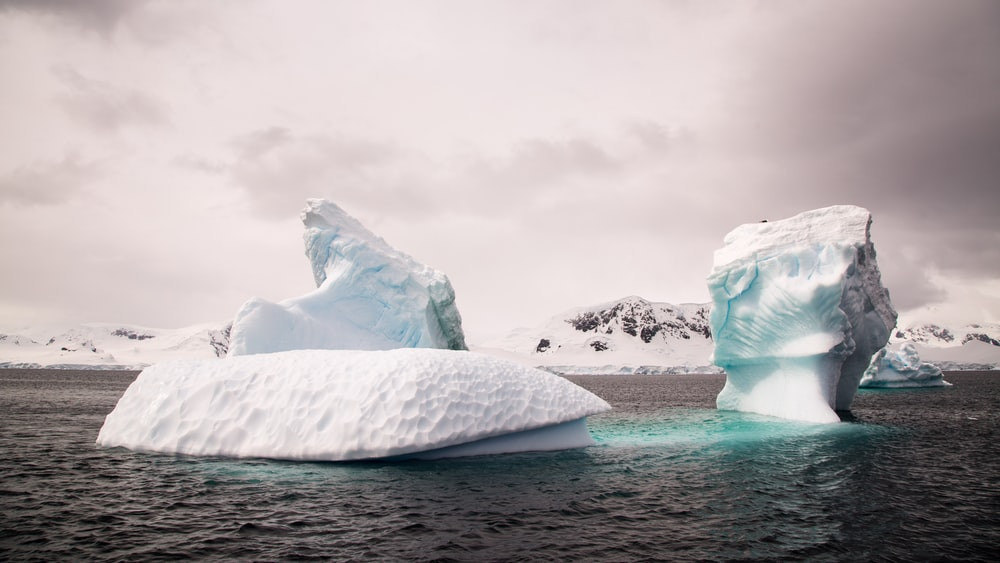 two ice bergs during cloudy day