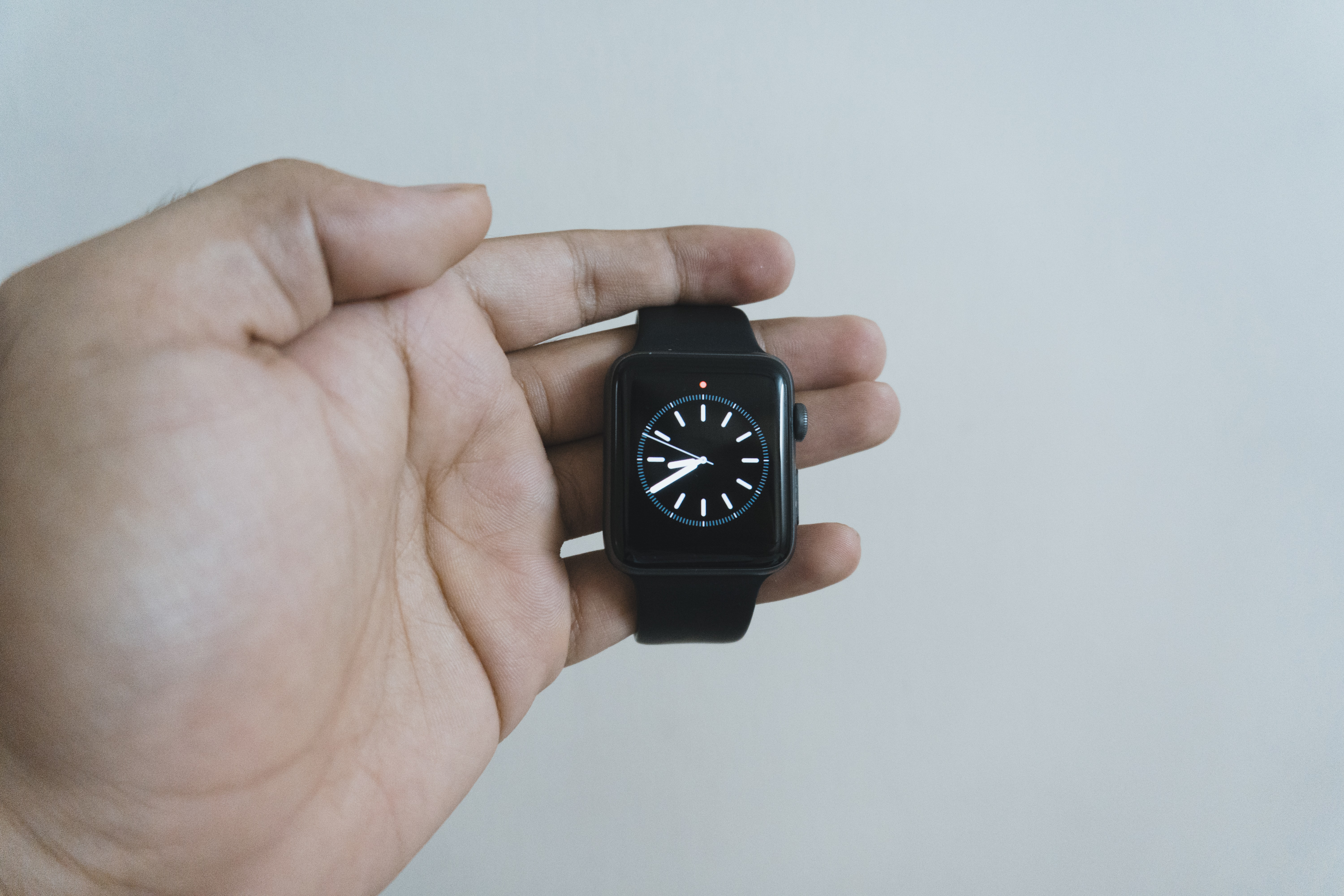 person holding apple watch at 8:40