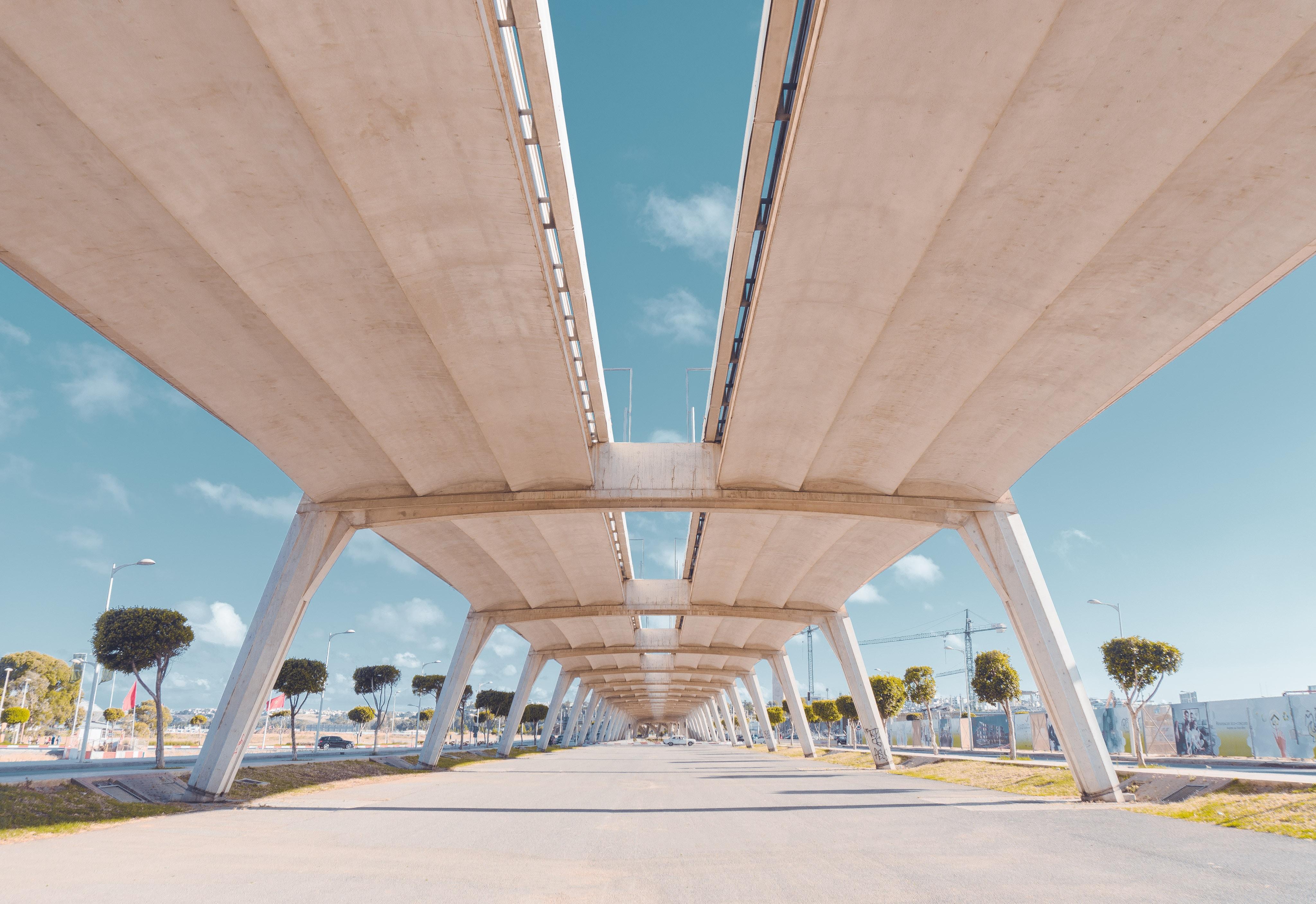 low angle photo of white concrete bridge