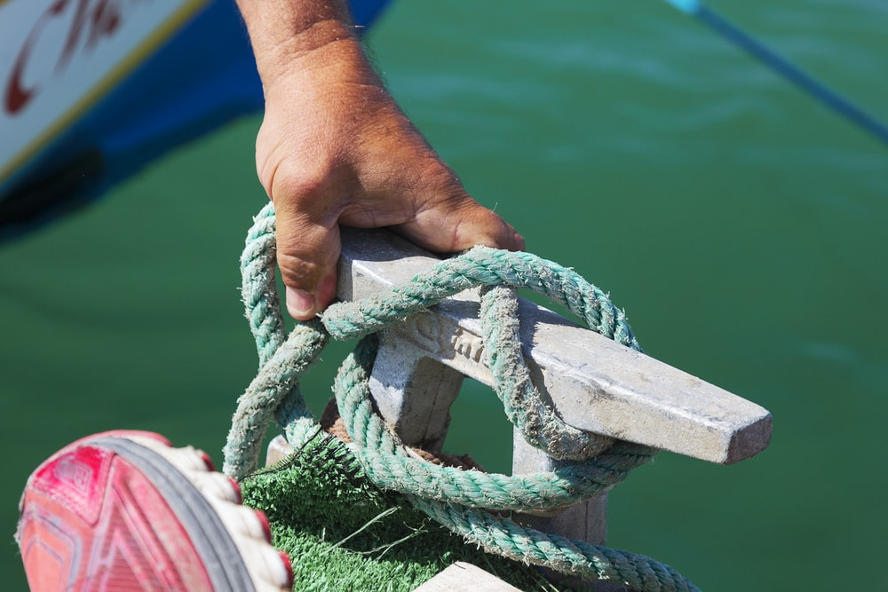 person holding green rope