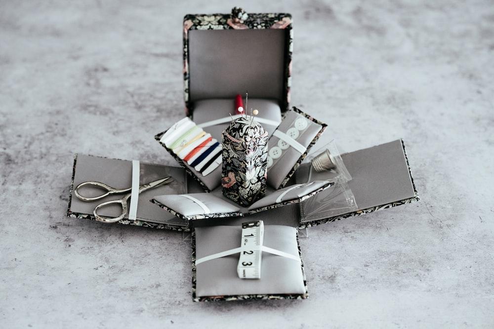 scissors and knitting kits on box