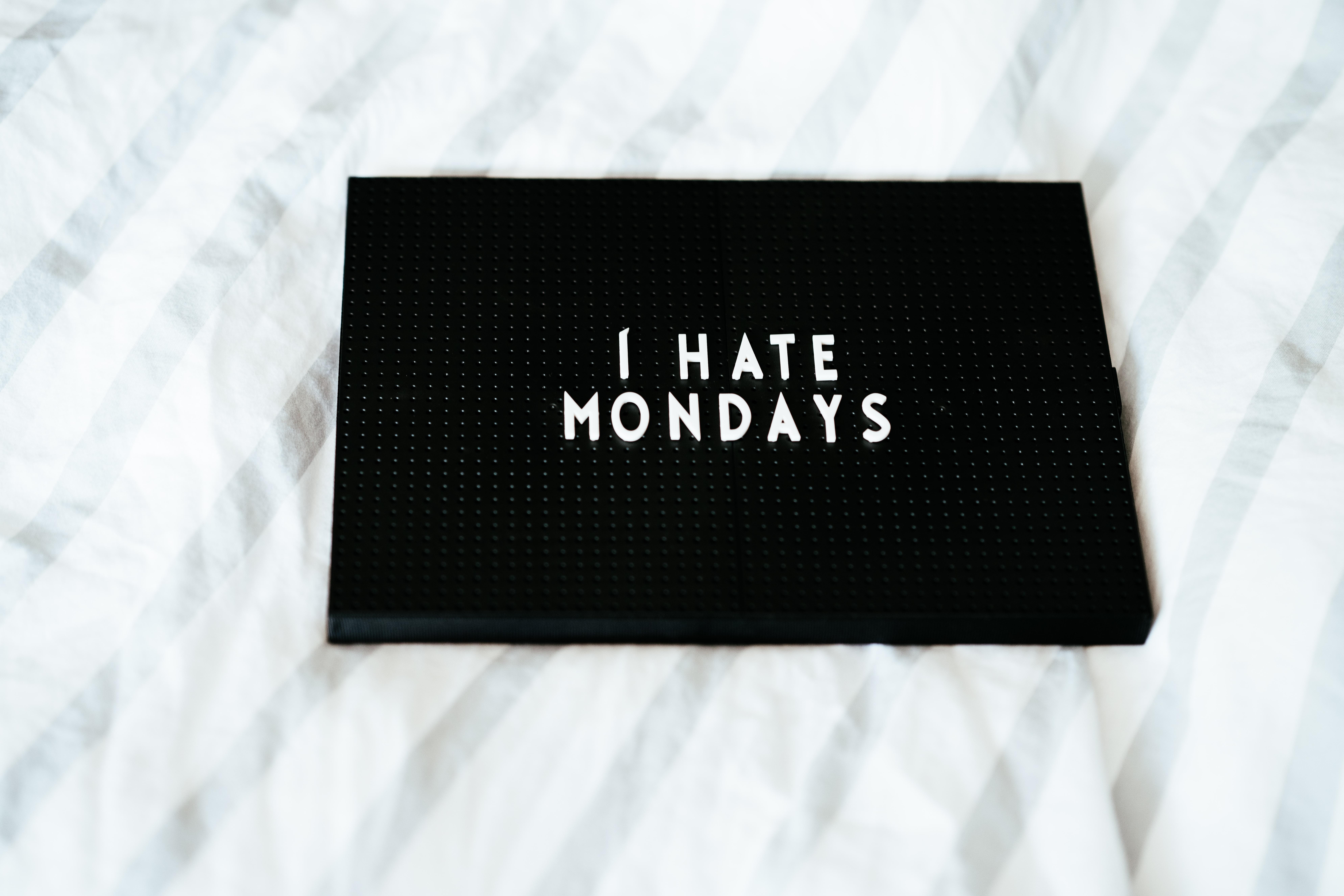 black i hate Mondays printed box on white textile