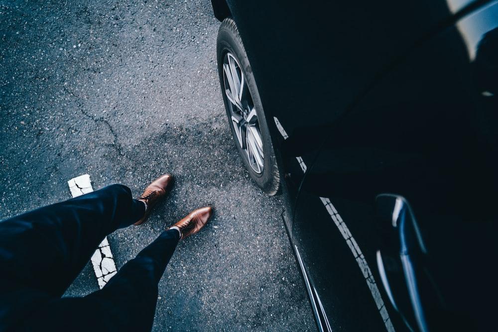 person standing near car
