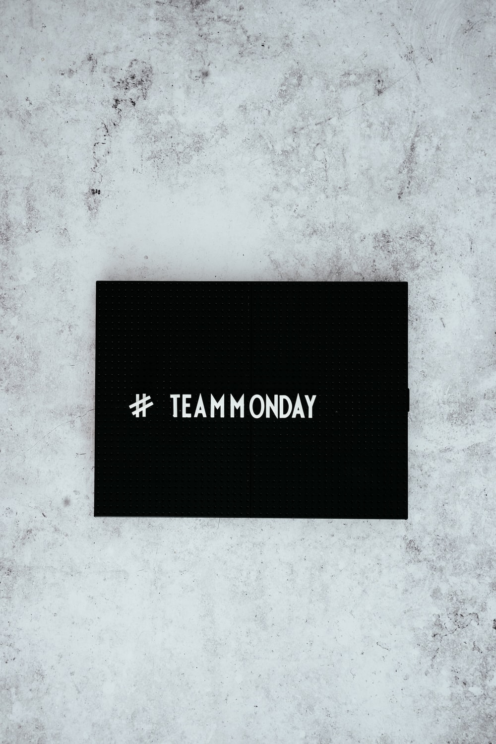 #team monday text overlay on black background