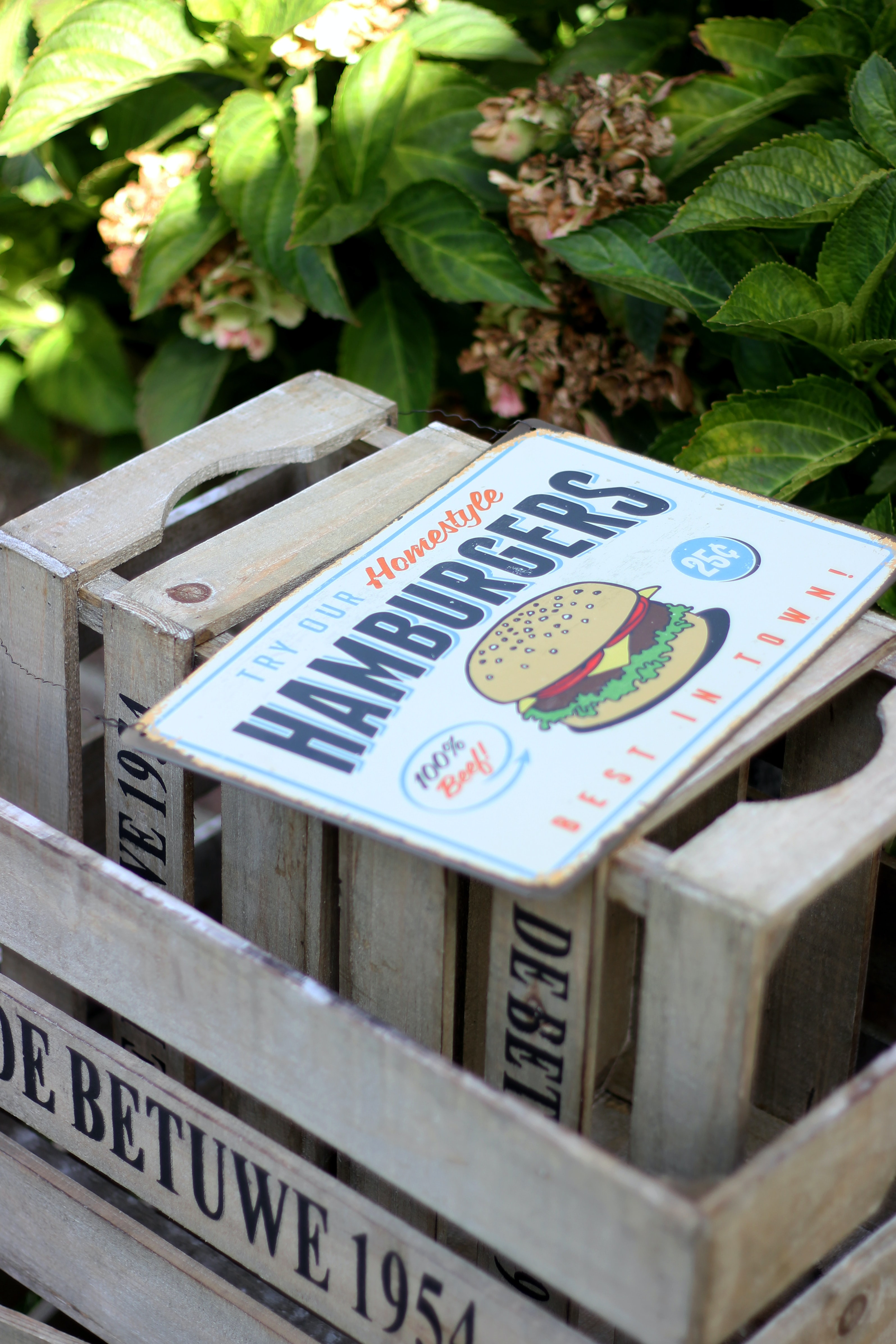 white and brown Hamburgers signboard