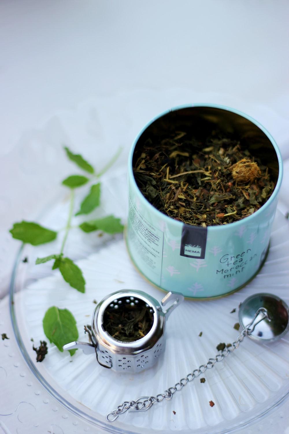 silver teapot near case